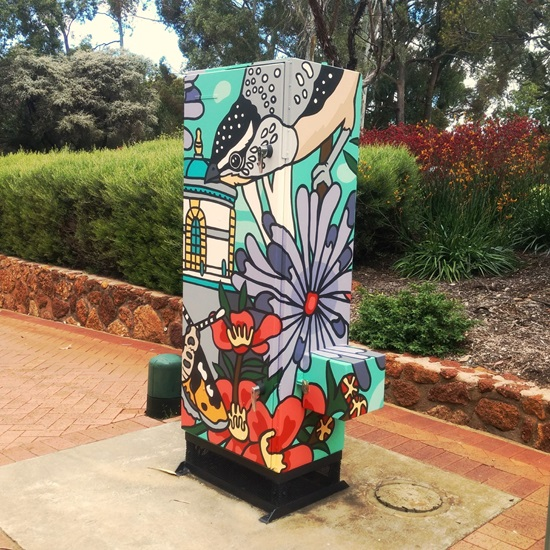 Watercorp cabinet decorated in colourful artwork.