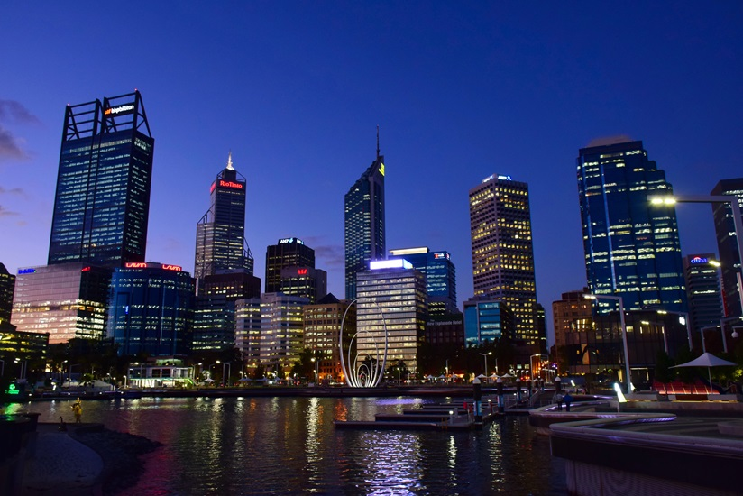 Photograph of City of Perth skyscrapers at night with river in foreground